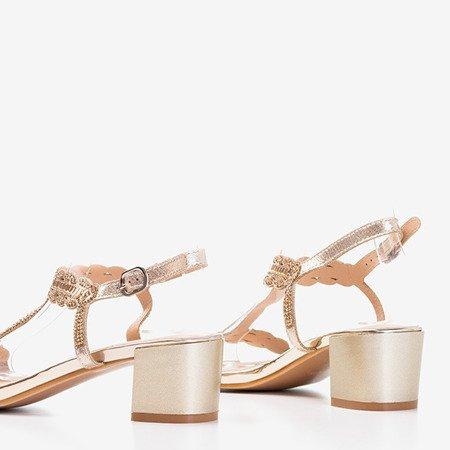 Золоті сандалі на низькому стовпі з кубічним цирконієм Doremies - Взуття