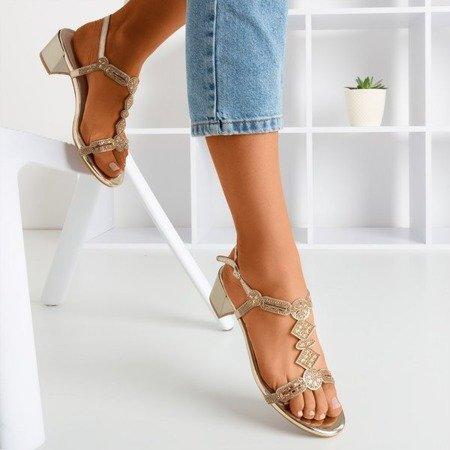 Золоті сандалі на низькому стовпі з фіанітом Doremia - Взуття
